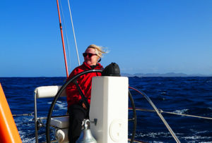 Nathalie at the helm, hair in the wind