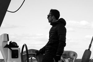 Jerome at the starboard helm, he's watching.